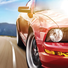 red car driving apply for a Cabrillo auto loan